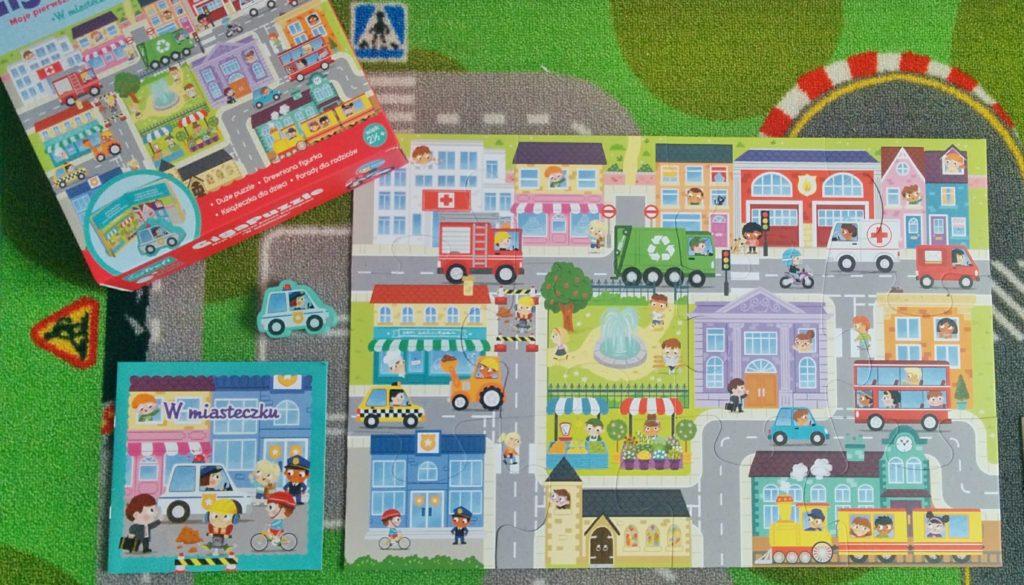 """Giga Puzzle """"W miasteczku"""" z serii little planet od Trefl co zawiera"""